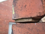 Severe horizontal cracking occurring as a result of wall tie corrosion