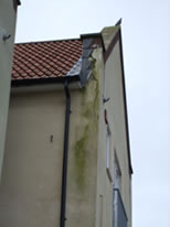 Severe penetrating damp issues caused by poor parapet wall detail