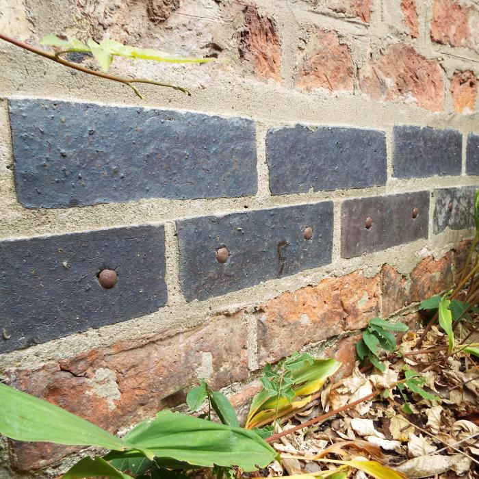 How many damp proof courses does one building need?.........