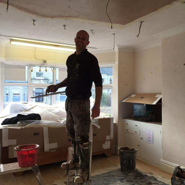 Our top plaster Steve undertaking repairs to this traditionally plastered lath and lime ceiling. Our staff aren't just remedial technicians, they're top tradesmen too!