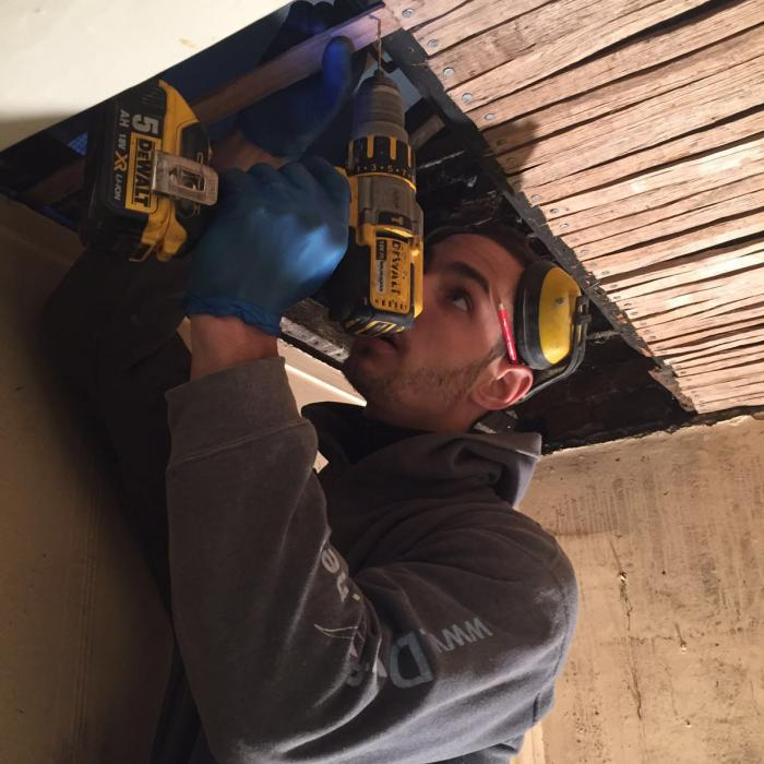 Our top joiner Fraser installing new oak laths during replacement of this traditional lath and lime plaster ceiling in Wakefield. Our staff aren\'t just remedial technicians, they\'re top tradesmen too!