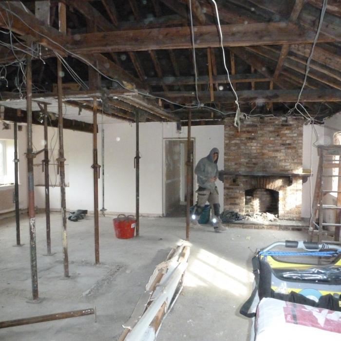 A project in Tadcaster where we have removed all the internal dividing walls to create one large  Kitchen / Dining room area. The specification is one large room with a vaulted ceiling perimeter and central well to include exposed French Oak beams. The existing fire place in addition to the chimney stacks at roof level will be completely dismantled and rebuilt including a log burning stove. Extensive rebuilding of the walls is required for this project in addition to support of the entire roof structure, wall plate and window openings. Large steel beams weighing in excess of 1 1/2 tonne each will be required to created the vaulted ceiling in addition to new steel work above all the window openings and roof structure . The existing roof structure will have a new roof frame built internally to create the shape of the vault in addition to providing support to the original roof and the whole roof is to be treated against wood boring inspects (woodworm). The entire room is also to be damp proofed and all walls re-plastered, including huge amounts of high specification insulation to be introduced into the roof and ceilings. . See following pictures of progress.  All work was completed by the Dryfix Team.
