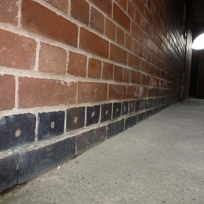 This contractor obviously decided this property had an issue with rising damp however their solution was to  inject a water repellent chemical directly into the buildings solid blue brick engineering damp proof course. These bricks are impermeable hence their primary use in below ground situations or as physical damp proof courses and as such will not absorb moisture. Another pointless damp proof course installation and a waste of time and money....