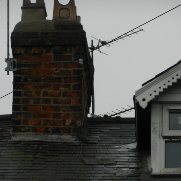 The main chimney stack of this Victorian terraced property in York circa 1900s was in poor condition with extreme sulphate attack causing distortion of the chimney.  This occurs as sulphates created by the burning of fossil fuels migrate through the chimney, attacking the mortar.  When the mortar is attacked it expands, resulting in the chimney buckling and changing shape which can also cause the brickwork within the chimney structure to collapse. 