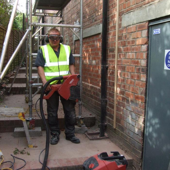 This is Alan Rutter who has worked for Dryfix since its initial set up in 2008. In this photo Alan is preparing to cut a 10mm expansion joint vertically up through a 100mm solid wall a total of 9 meters high using a specialist Hilti diamond cutting dust extraction system.