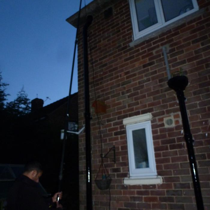 One of our surveyors undering a roof and gutter inspection using our remote illuminated camera on a telescopic pole. This camera system links to a ground monitor allowing us to view live footage at height with a total reach of 12 vertical meters.  Our telescopic camera can record both still images and video footage on our portable DVR.