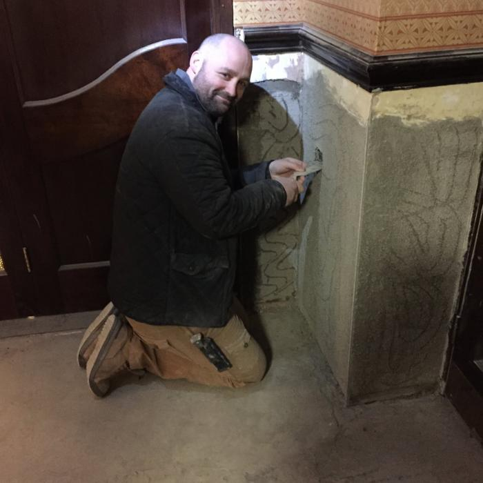 Our top plasterer Andrew Haigh preparing walls for skim plaster following extensive repairs at the Grand Opera House in York. Our staff aren't just remedial technicians, they're top tradesmen too!