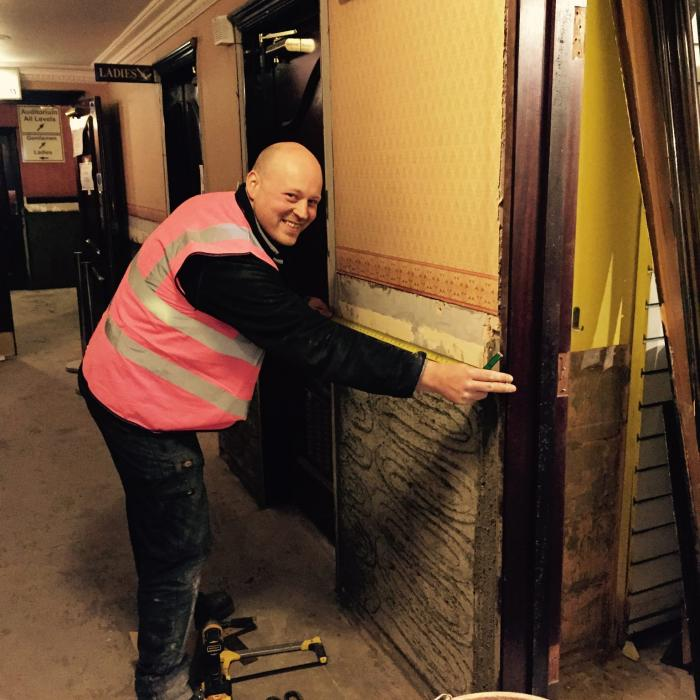 Our top joiner Matthew, measuring up woodwork during reinstatement works to  the Grand Opera house during flood restoration following the devastating floods in January 2016.