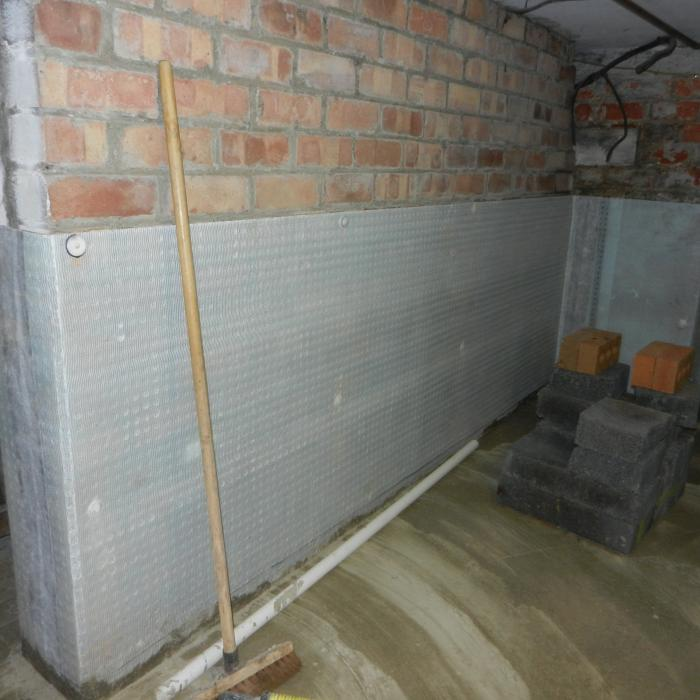 A simple water proofing project in York. This basement was only used for storage however regular flooding of the room prevented its use. We designed a water management system which incorporated a series of interlinked floor and wall cavity drain membranes including a below ground chamber and sump pump to help keep the basement dry. A new concrete floor was laid on top of the system providing a dry storage area for the owners. Whilst in this case the system was only used for water proofing the basement for storage, we have designed the system such as if in the future the client wants to fully convert the room a simple addition to the system we have installed would make this possible.