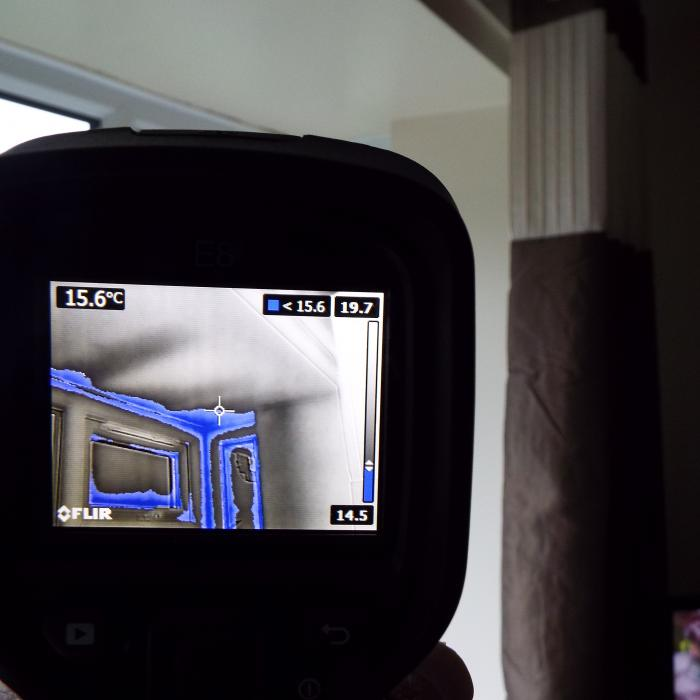 Thermal imaging combined with atmospheric monitoring allows us to programme and establish the area's most at risk of condensate and mould issues when establishing the dew point temperature. Here you can see the ceiling and window reveals of this bay window which are within the region of the dew point temperature and are highlighted in the greyscale image in blue.