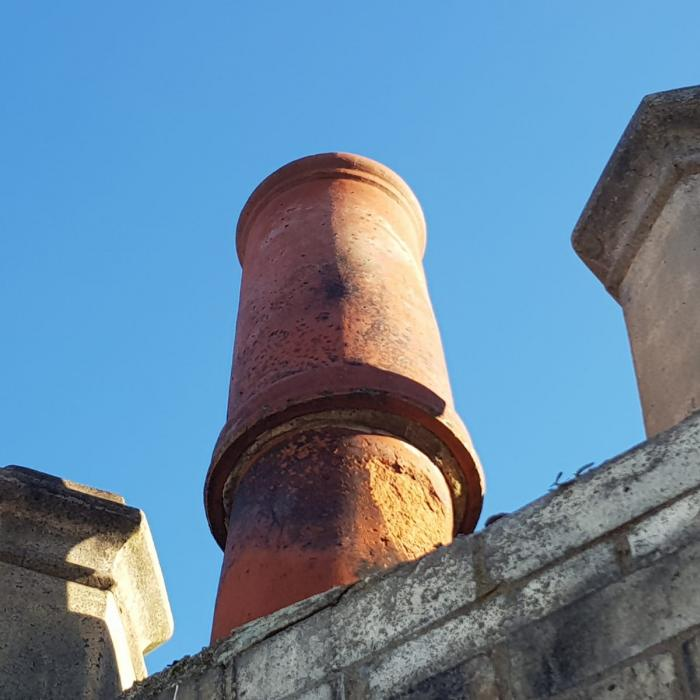 Chimney pots too small, problems with back draft?.... No worries we'll just stick another one on top!