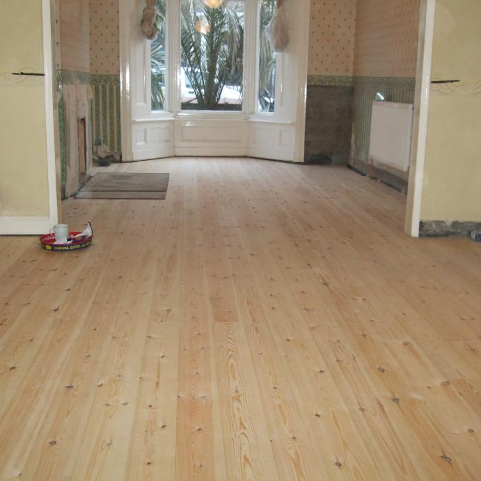 Replacement floor with secretly nailed floorboards for a beautifully finished floor.
