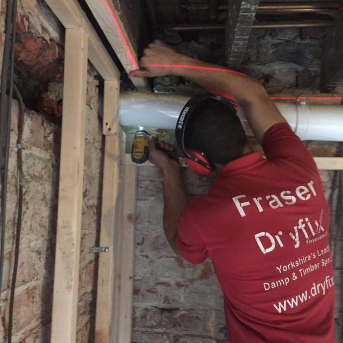 Our top joiner Fraser, installing framed linings during restoration of a flooded property in York.