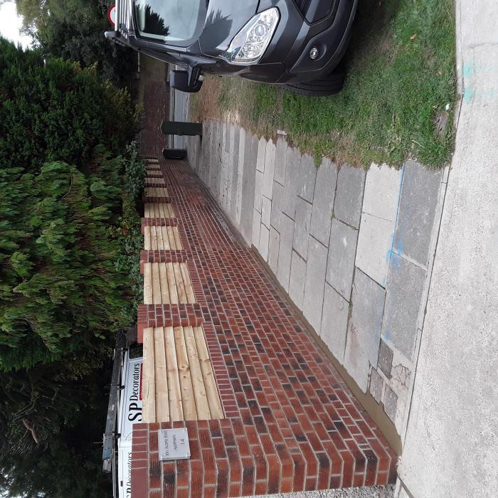 James and team have just rebuilt this exteremly long wall for an insurance company after a car accidently hit the wall and caused a partial collapse.