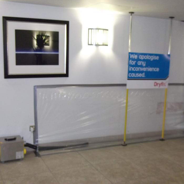 A water damaged wall caused by a leaking bathroom on the opposite side is being dried using a closed drying system using specialist desiccant dehumidifiers in a public building. Using our advanced drying systems we were able to salvage the plaster and reduce drying times dramatically saving our client the expense of reinstating the plaster and decor and a reduction in drying costs.