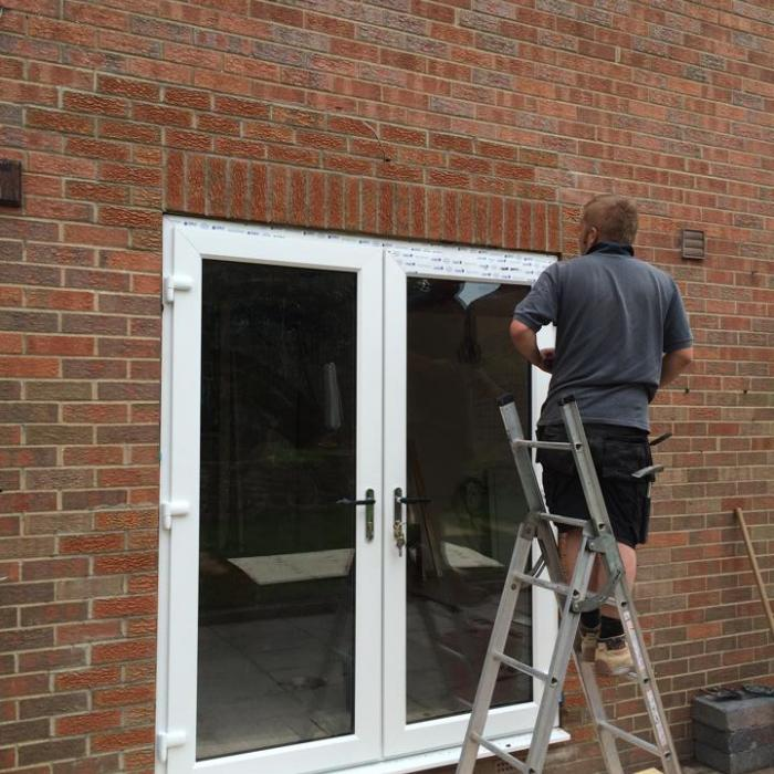 Alan's just putting the finishing touches to his immaculate brickwork following this structural alteration and amendment to an existing window opening which is now a beautiful pair of French doors.